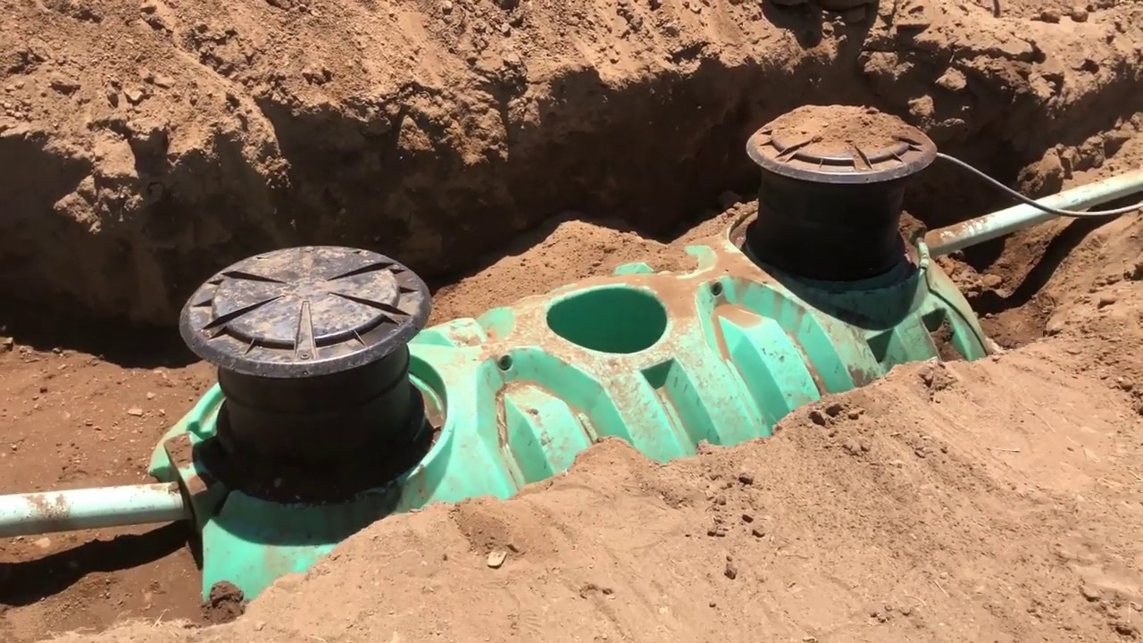 Installing a new septic system including tank and  leach field